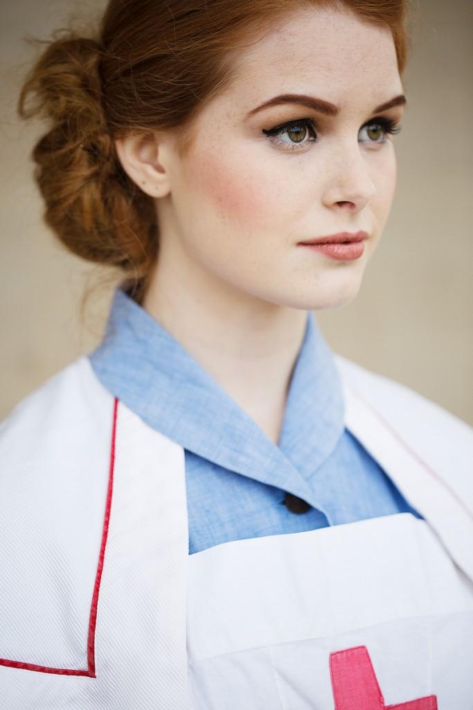 Beautiful young 1940's nurse in uniform