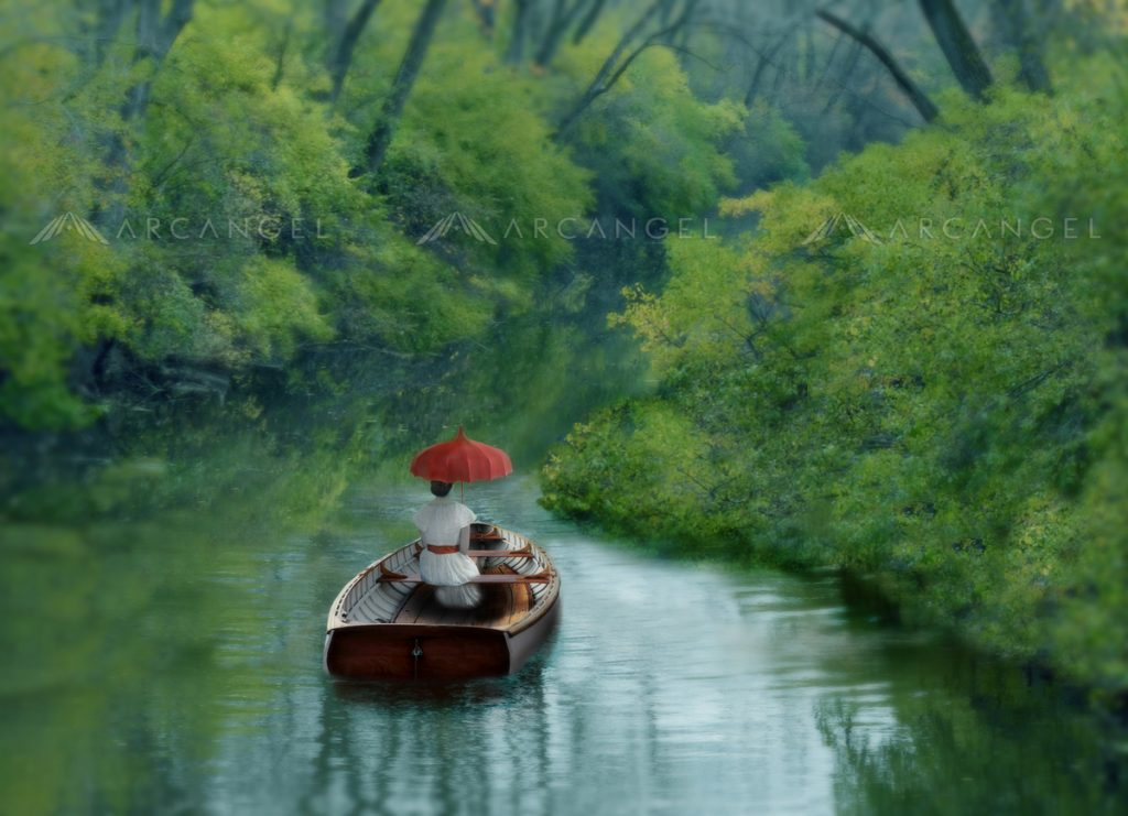 Lady in a row boat on a river.